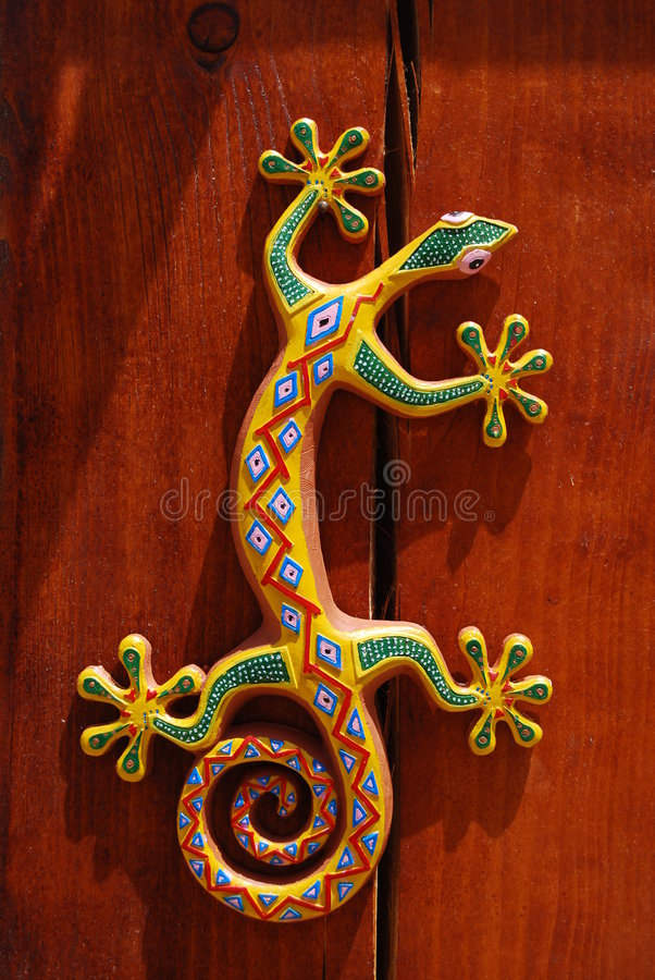 Colored lizard. Design colored lizard on wall royalty free stock photos
