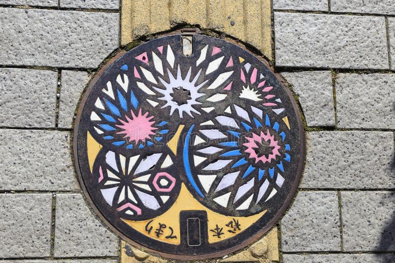 Colored manhole cover in matsumoto stock images