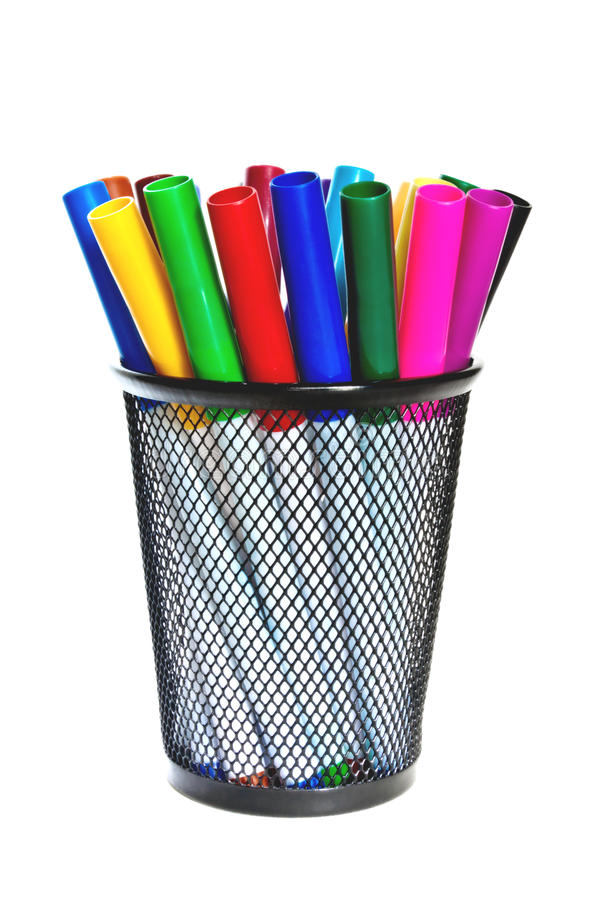 Colored markers in a cup. Colored markers in a cup on a white background royalty free stock images