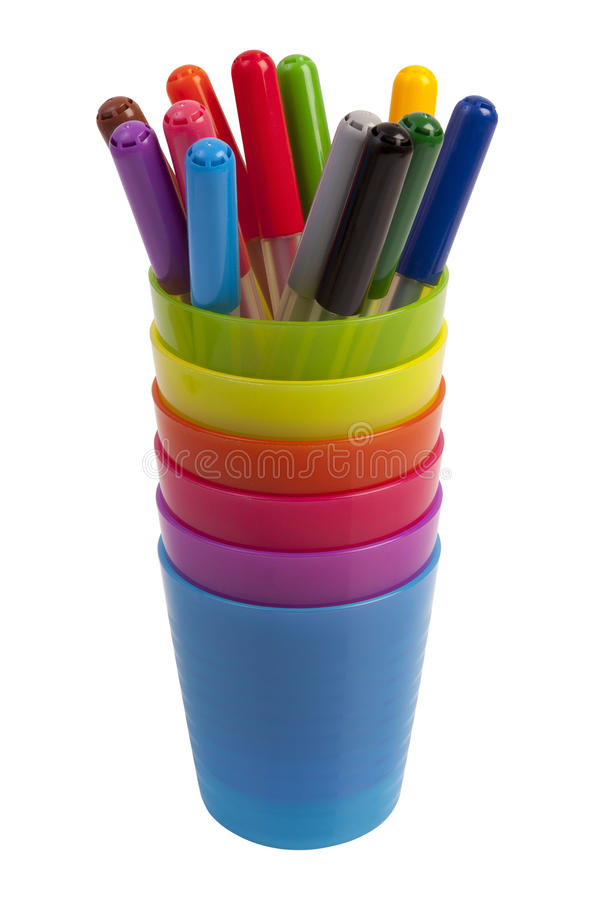 Colored markers in a stack of colored plastic cups isolated on white stock images