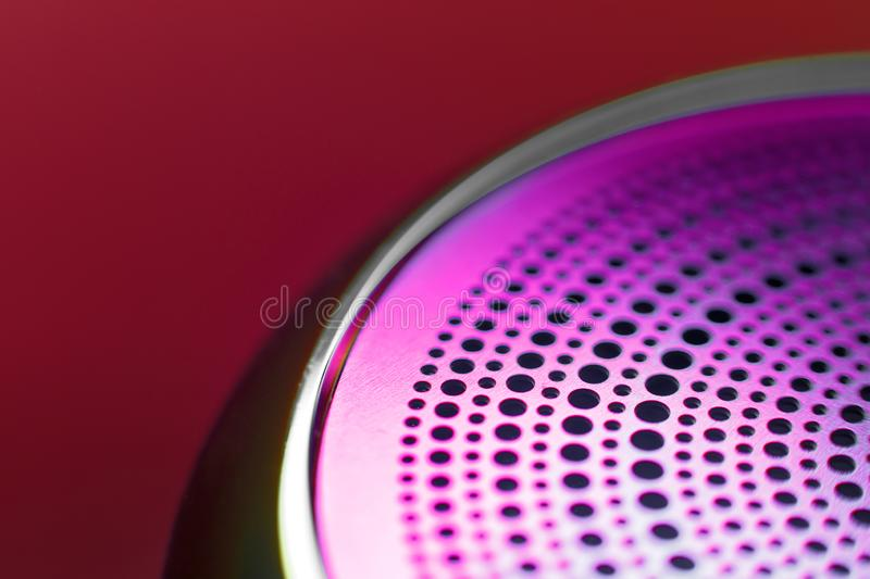 Colored metal thing with holes perforated in a circle. Background. selective focus.  stock photos