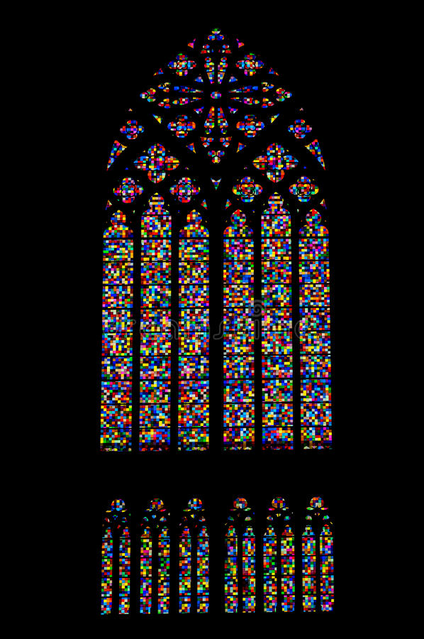 Colored mosaic stained glass window of gothic church stock photos