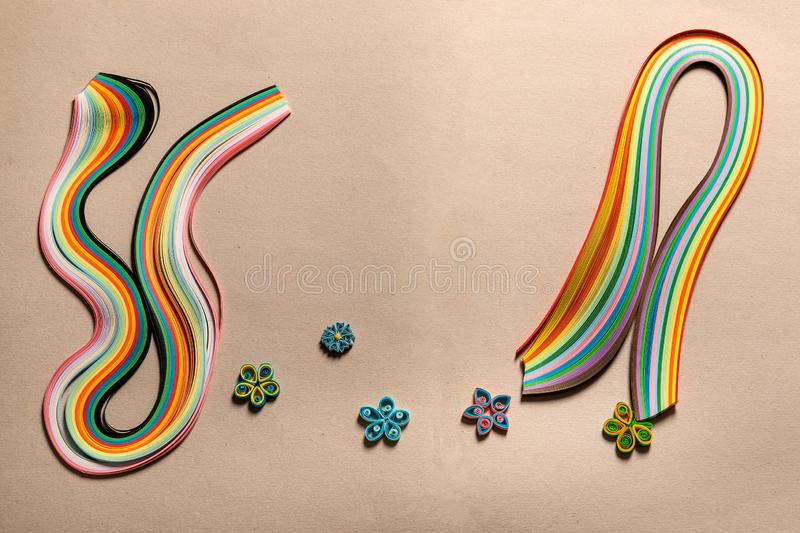 Colored, multi-colored paper special strips for quilling on cardboard for hobbies , figures for decoration royalty free stock photography