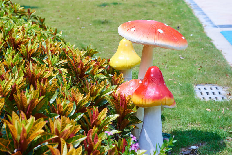 Colored mushroom sculpture for garden decoration stock photography