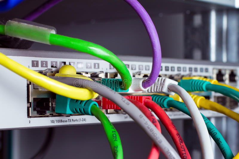 Colored network cables connected to switches royalty free stock photography