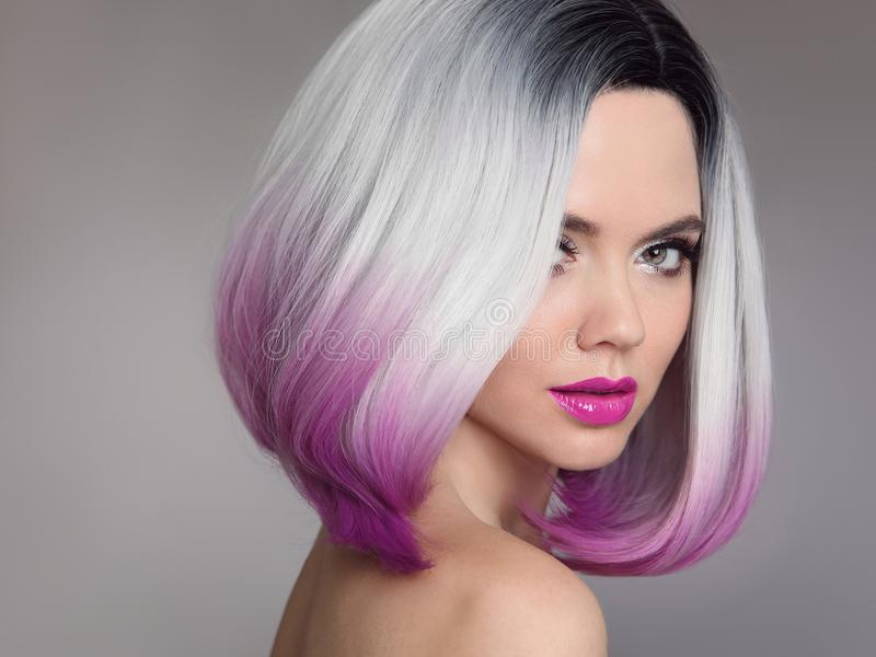 Colored Ombre hair extensions. Beauty Model Girl blonde with short bob purple hairstyle isolated on gray background. Closeup stock photo