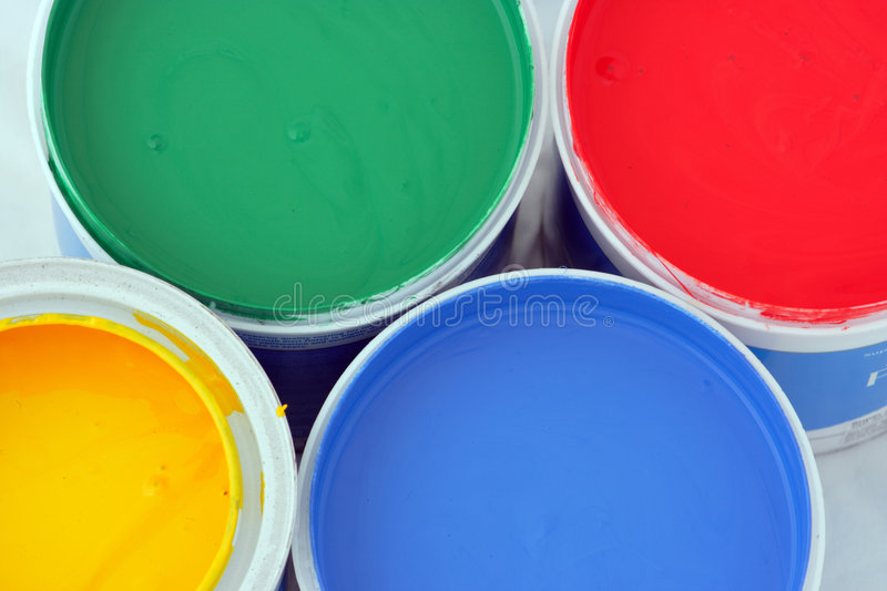 Colored paints. Vertical picture of paints in red,blue,green and yellow royalty free stock image