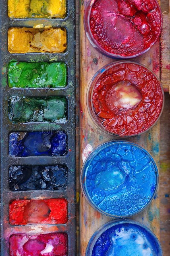 Colored paints. Close up of a color palette with various colors
