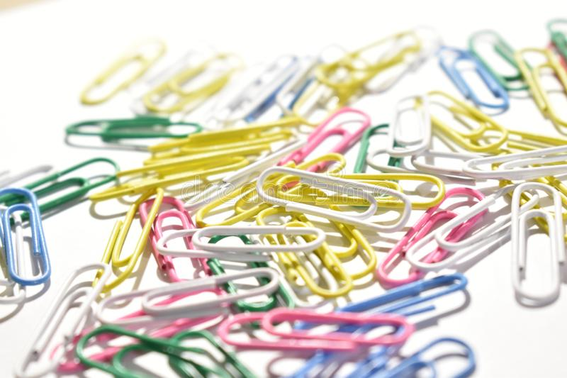 Colored paper clips in the light. royalty free stock image