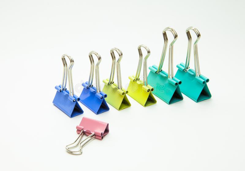 Colored paper clips on a white background, close-up royalty free stock images