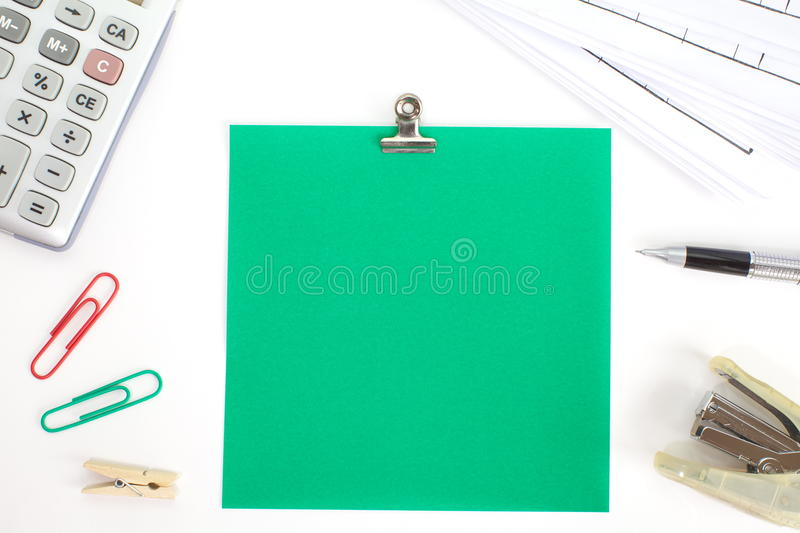 Colored papers with staple and stationery. Photo of Colored papers with staple and stationery stock image