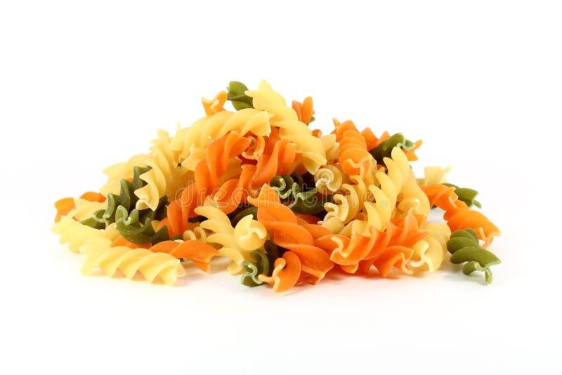 Colored pasta fusilli stock image