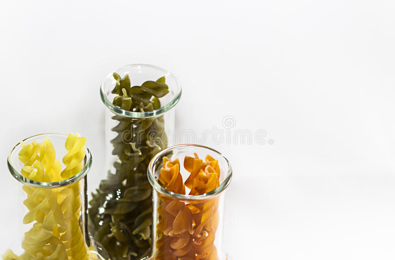 Colored pasta in a glass royalty free stock image
