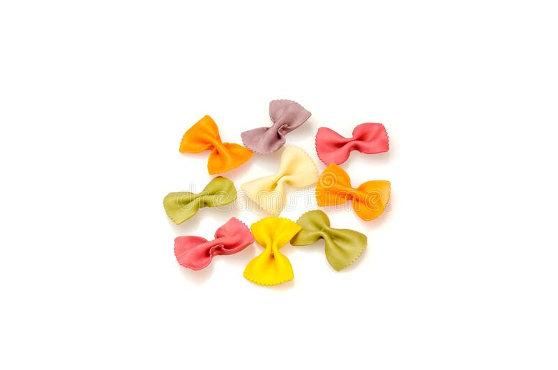 Colored pasta in the shape of bows stock images