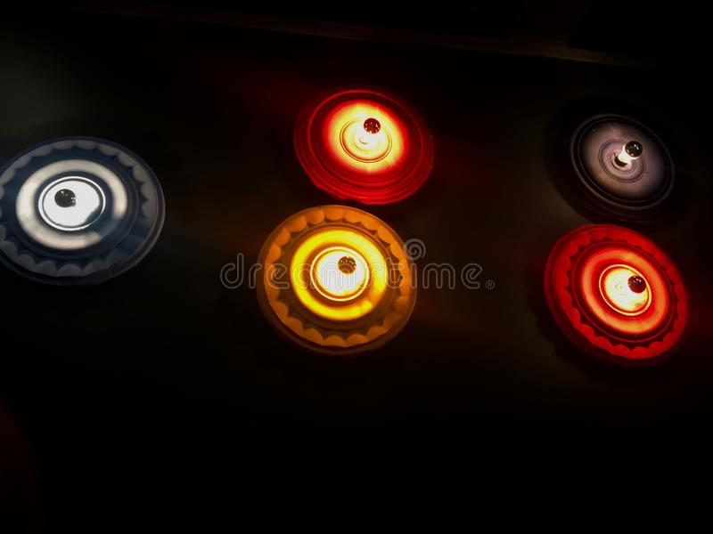 colored patterned lamps on the wall stock image