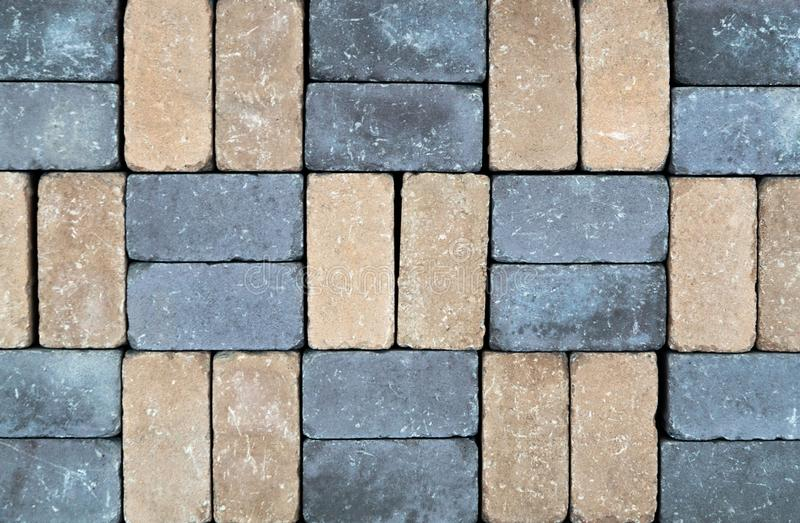 Colored paving slab with a beautiful high-quality texture close up. Colored concrete paving slab with a beautiful high-quality texture close up stock images
