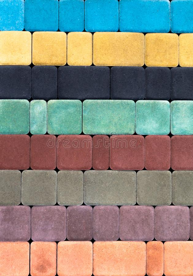 Colored paving slab with a beautiful high-quality texture close up. Colored concrete paving slab with a beautiful high-quality texture close up royalty free stock photography