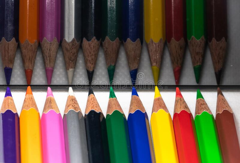 Color Pencil with different color. A colored pencil American English, coloured pencil Commonwealth English,[1] pencil crayon, lead or coloured/colouring lead stock photography