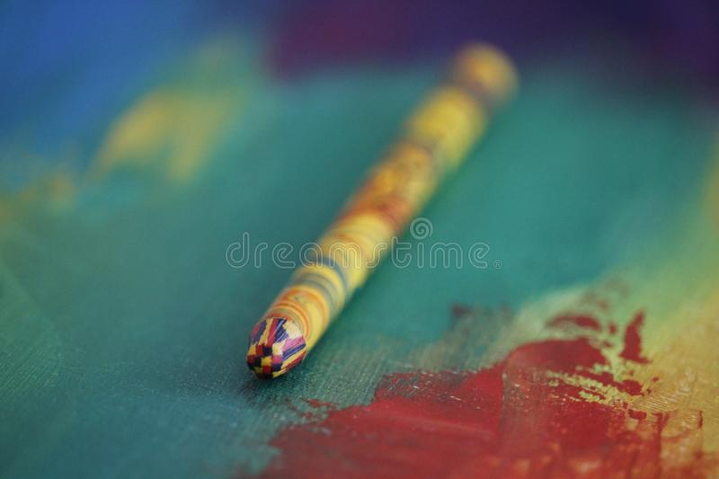 Three colored pencil on the canvas  adstract painting royalty free stock photo