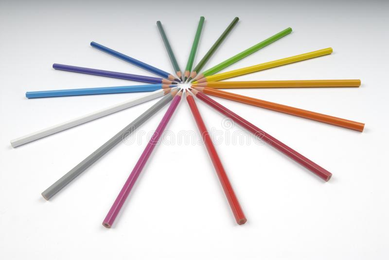 Colored pencil in circle disposition. Colored pencil still life in the study royalty free stock photography