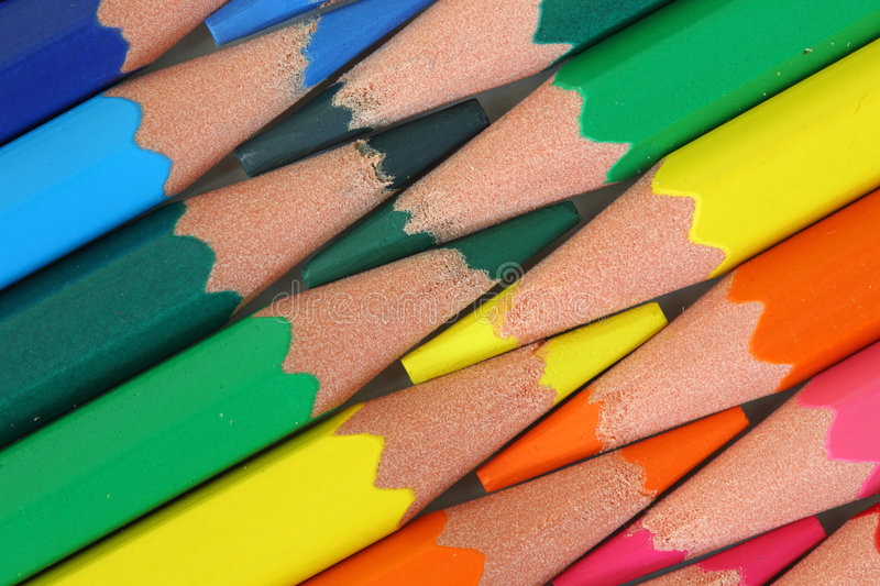 Colored pencils. Colored wood-free pencils close up royalty free stock images