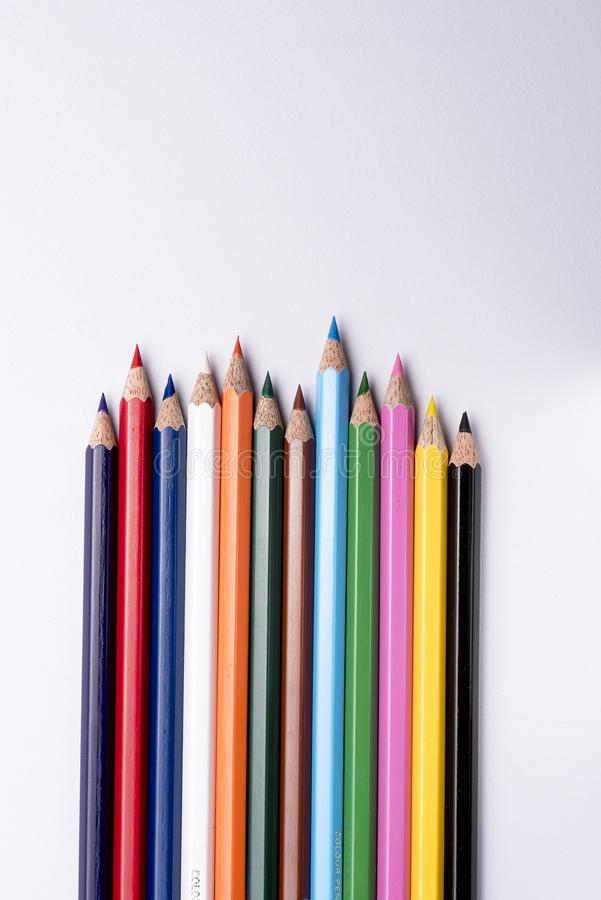 Color pencils arranged on a isolated white background. Colored pencils arranged on an isolated white background royalty free stock photography