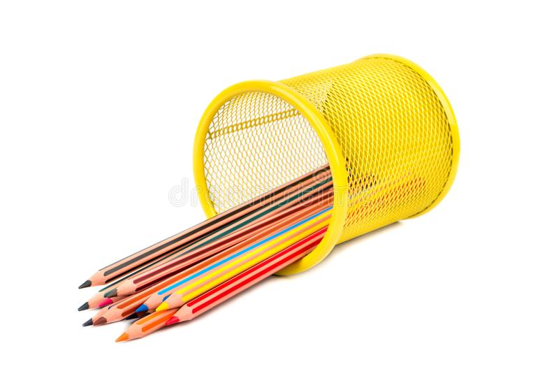 Colored pencils in basket. Inverted iron basket with multi-colored pencils on white background royalty free stock photos