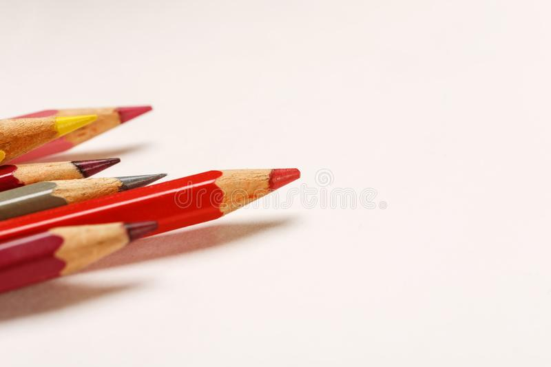 Colored pencils on a blank white sheet of paper, macro shot stock photo
