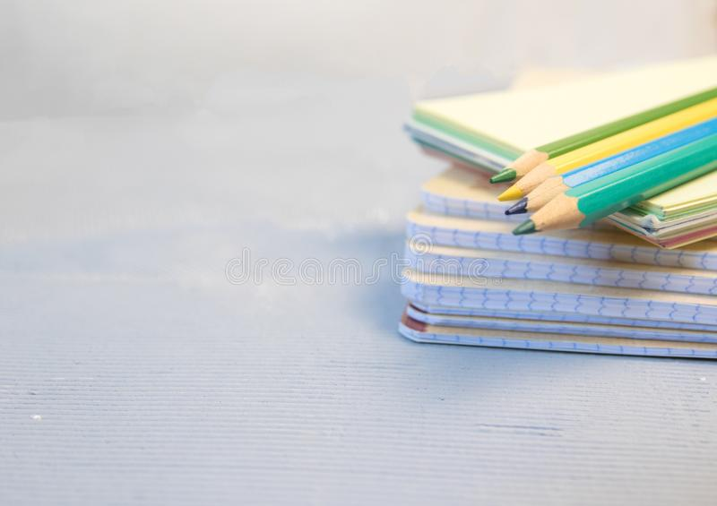 Colored pencils and a drawing pad. The concept of school children`s creativity stock photo
