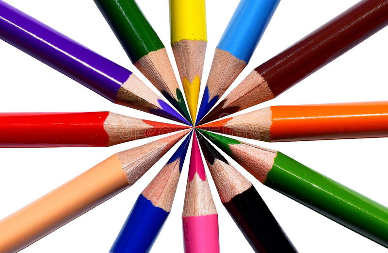 Colored pencils. Flower shape. Children  piled around a central point stock photography