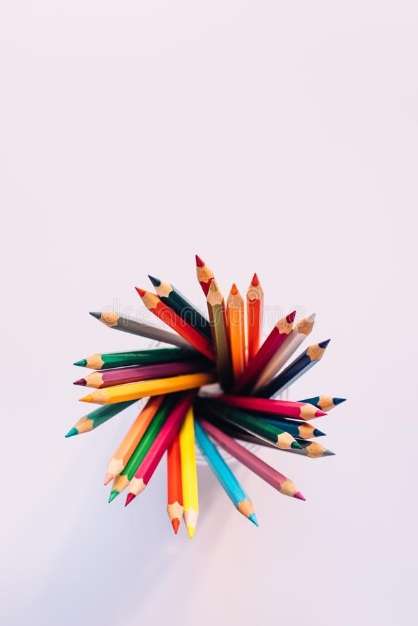Colored pencils in a glass stock photo