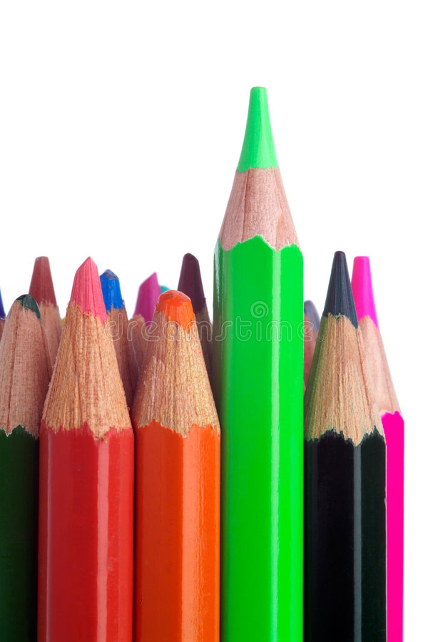 Colored pencils, with the green standing proud