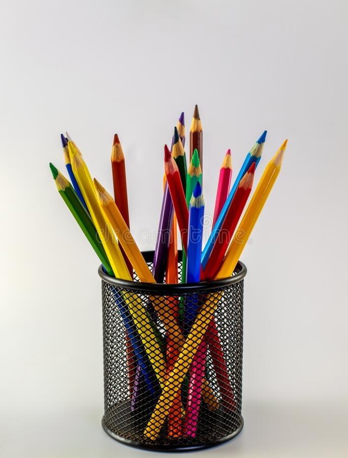 Free Colored Pencils In Mesh Pencil Holder. Isolated, Copy Space For Text. Royalty Free Stock Photography - 171512897