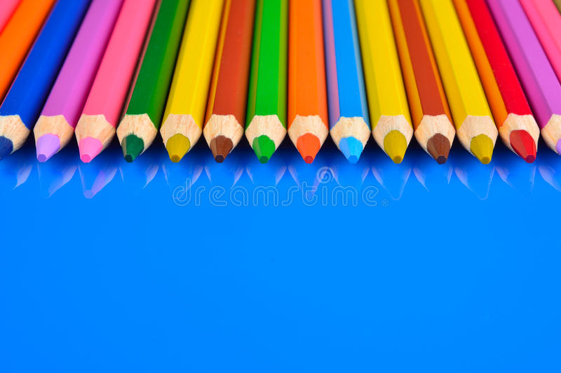 Download Colored Pencils Isolated On Blue Background With Reflection Stock Photo - Image: 83702138