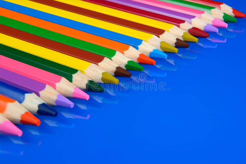 Download Colored Pencils Isolated On Blue Background With Reflection Stock Photo - Image: 83702199