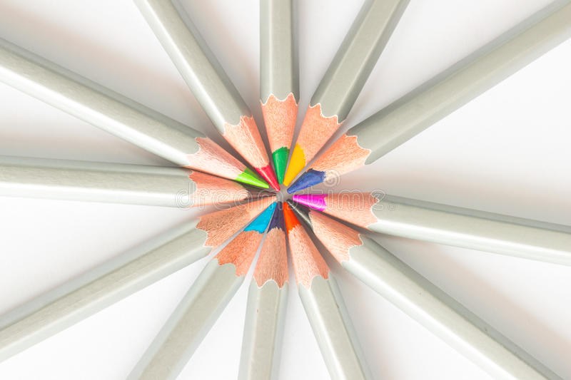 Colored pencils lined in a circle stock image