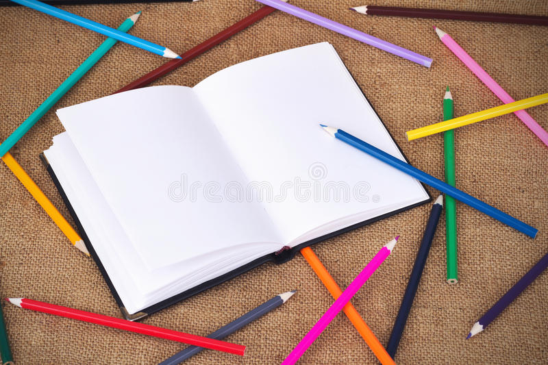Colored pencils and notebook royalty free stock images
