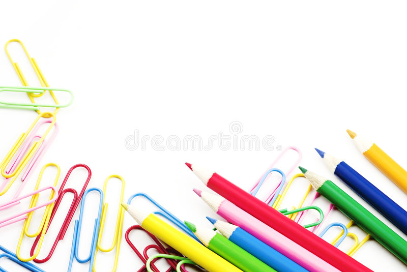 Colored Pencils and Paperclips. Colored pencils and colored paperclips on a white background copy space royalty free stock photo