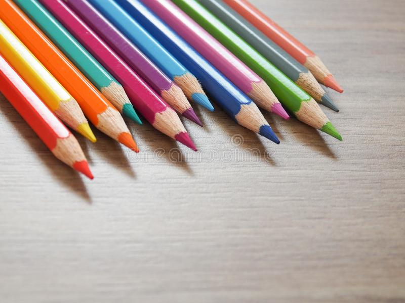 Colored Pencils. Place on wooden background royalty free stock images