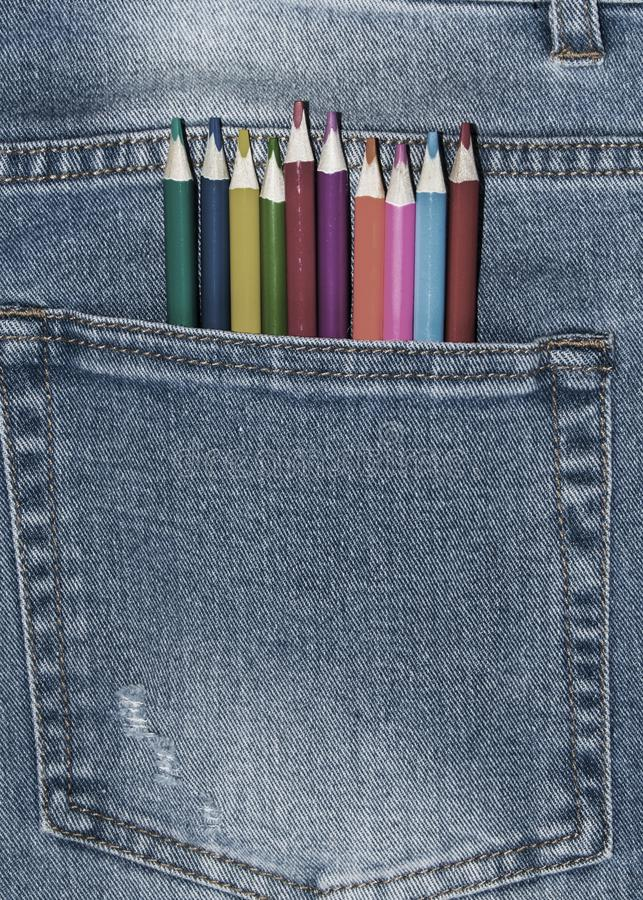 Colored pencils are in the pocket of jeans stock images