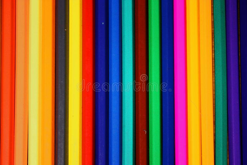 Colored pencils row background / texture royalty free stock photo