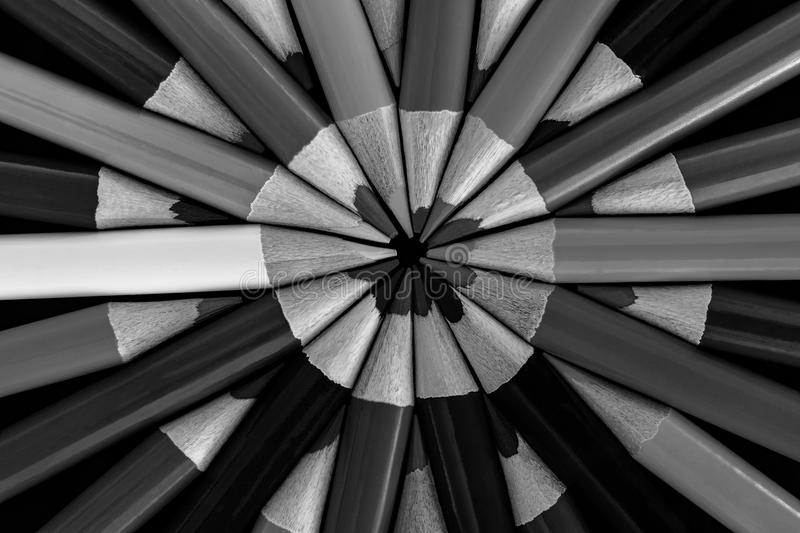 Colored Pencils in a symmetrical Pattern Abstract in Black and White royalty free stock images