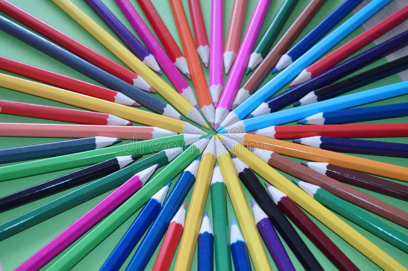 Colored pencils on the table. As background.Back to school royalty free illustration