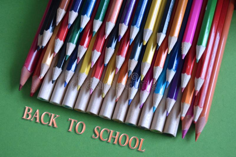 Colored pencils on the table. As background.Back to school stock illustration