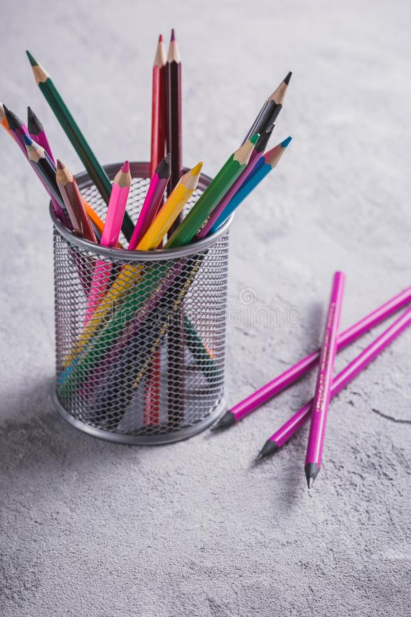 Colored pencils on the table stock image