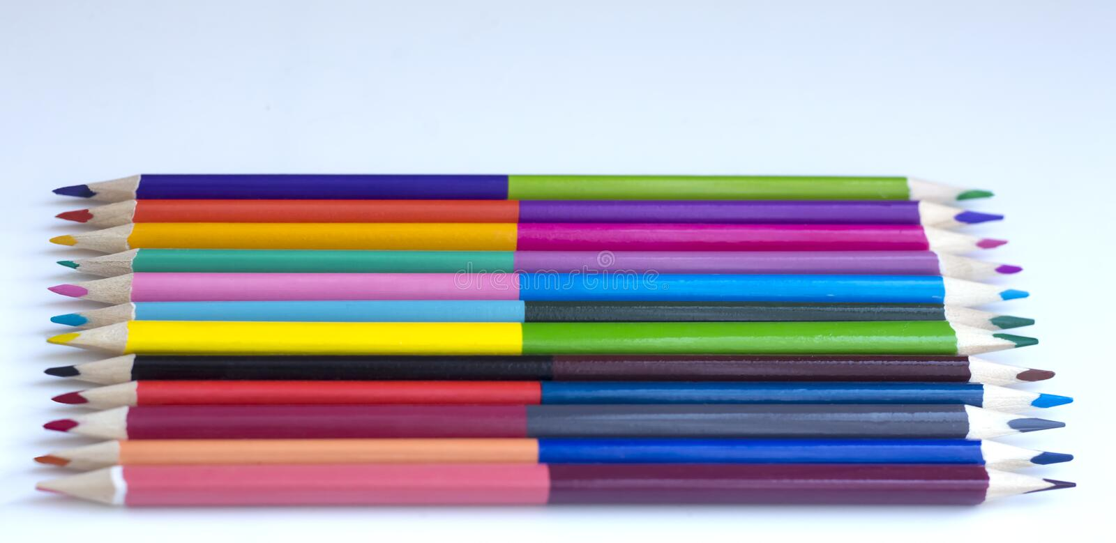 Colored pencils on white background stock photography