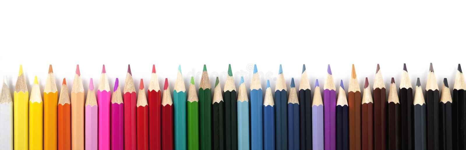 Colored pencils on a white background. Panorama. royalty free stock photos