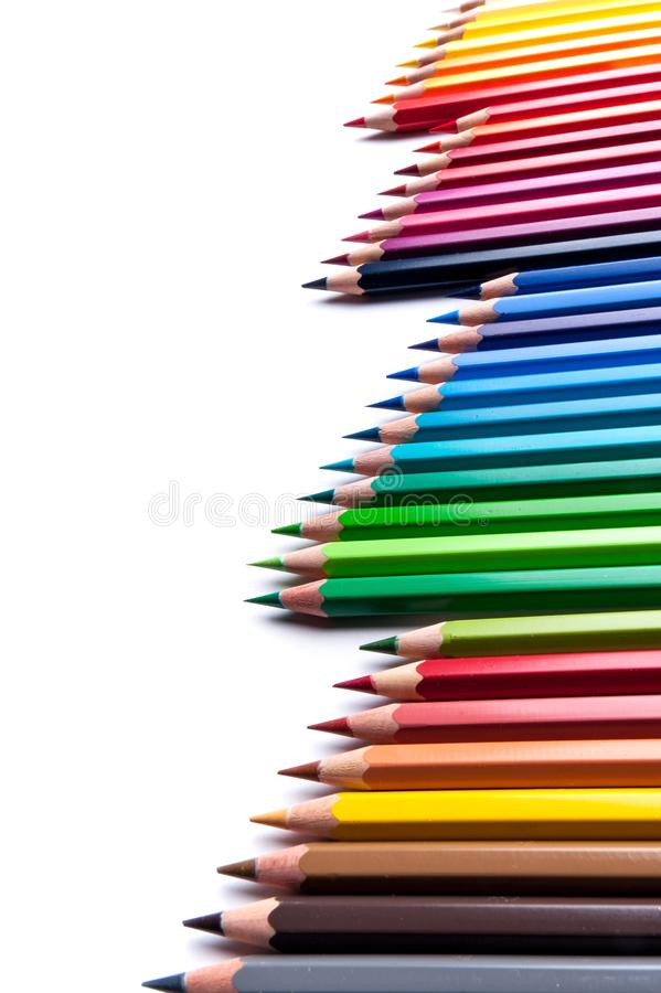 Colored pencils on white background. Set of colored watercolor wooden pencils, professional palette stock photos