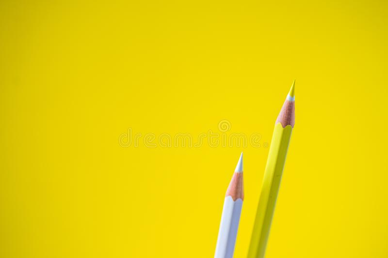 Colored pencils on a yellow background with space for text royalty free stock images