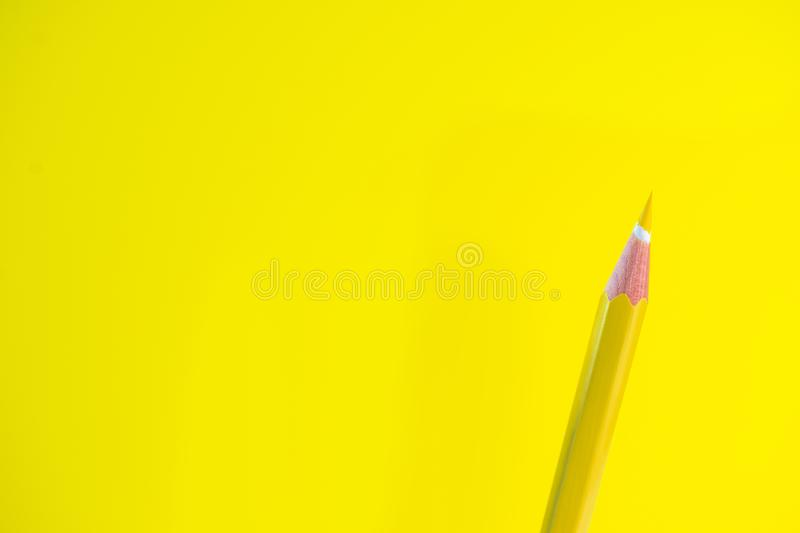 Colored pencils on a yellow background with space for text stock photo